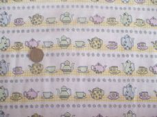 TEAPOTS CUPS AND SAUCERS 100% COTTON  CHILDRENS PRINT FABRIC PER 1 METRE LEMON